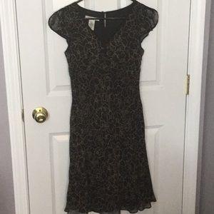 Black silk dress with beige flowers